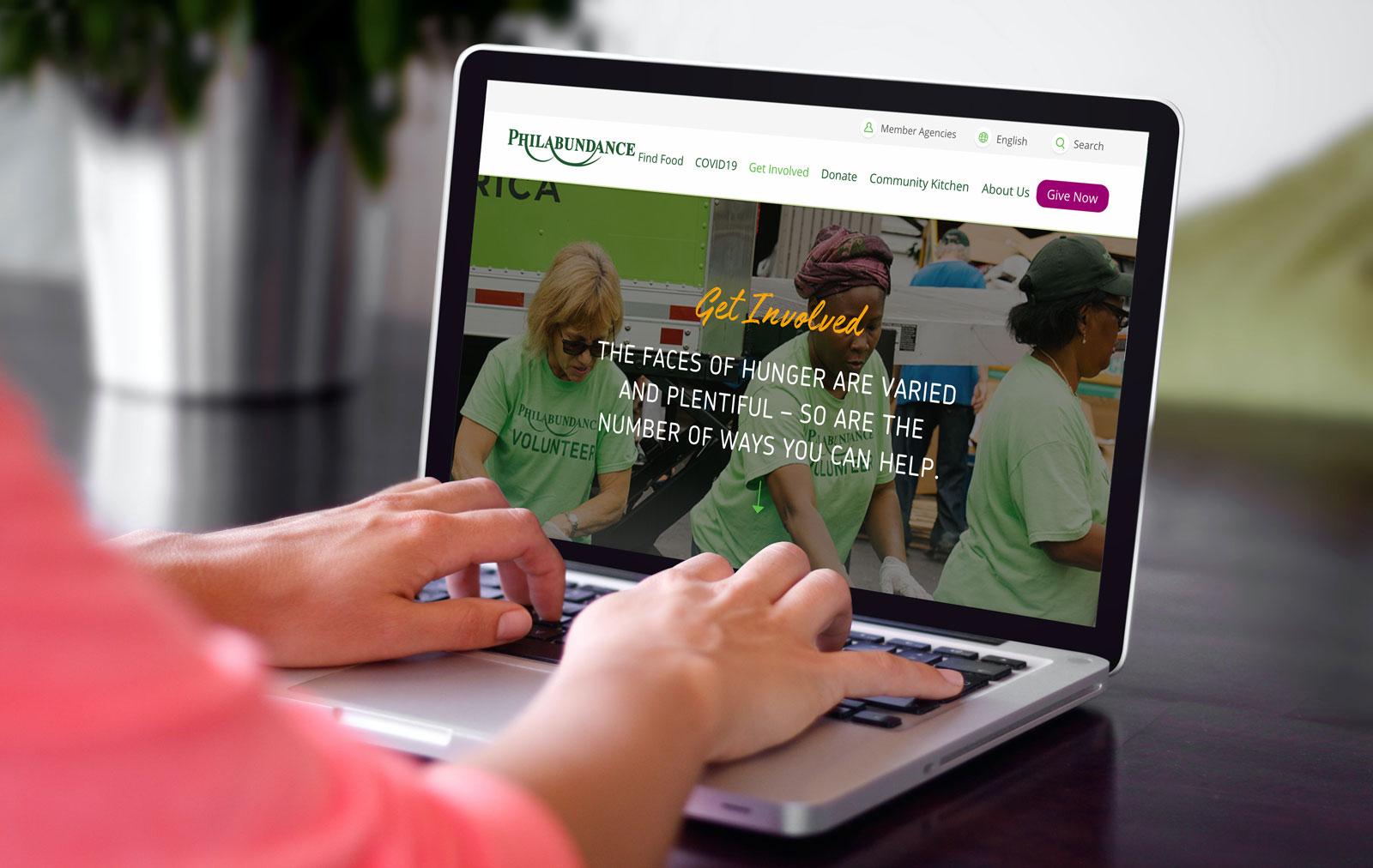Philabundance Homepage Website Design on Laptop
