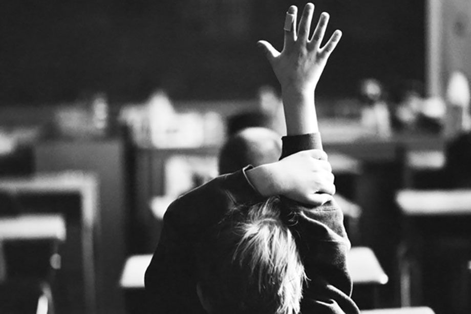 website cost, kid raising hand in class