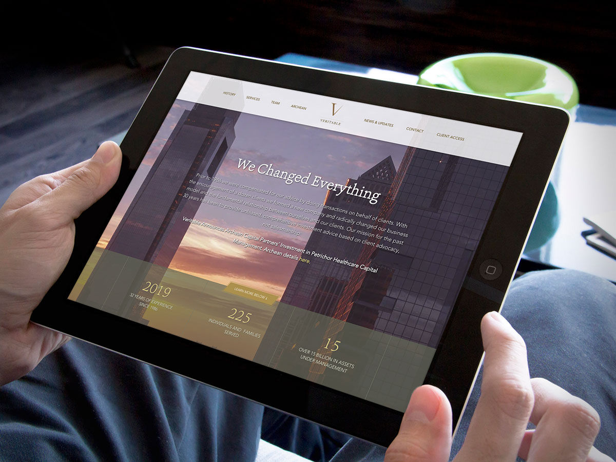 wealth management web design shown on mobile device